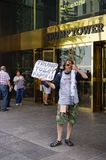 A protester sellingTrump toilet paper in front of the Trump Tower in New York. NEW YORK, NY - A protester against Republican nominee Donald Trump sells Trump Stock Image