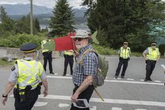 Police arrest Kinder Morgan protester at the Wstridge Marine Terminal in Burnaby, BC. Protester at the Westridge Marine Terminal in Burnaby, BC is arrested and royalty free stock photos