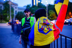 Protester wrapped in romanian flag, Bucharest, Romania Stock Image