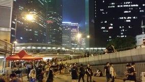 Protesterare i revolutionen 2014 för det Harcourt Road Occupy Admirlty Hong Kong protestparaplyet upptar centralen Arkivfoto