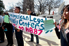 Protesters carrying sign opposing immigration bill Royalty Free Stock Images