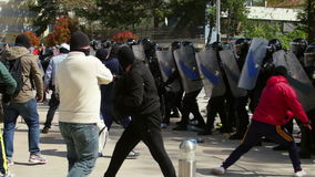 Protesters clash with riot gendarmerie during a riot-control exercise