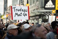 Protesters Demand `Trudeau Must Go` at March for Freedom in Toronto, Ontario