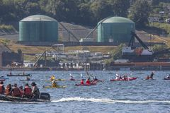 Protect the Inlet Flotilla and water ceremony. Protesters in a flotilla of kayaks and canoes cross the Burrard inlet to gather near Kinder Morgan`s Westridge stock image