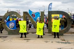 Protesters gather outside the main gate to the AWE, Aldermaston. Aldermaston, United Kingdom, 1st April 2018:- CND protesters gather outside the main gate to the stock photography