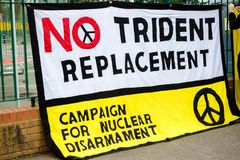 Protesters gather outside the main gate to the AWE, Aldermaston. Aldermaston, United Kingdom, 1st April 2018:- CND protesters gather outside the main gate to the royalty free stock photo