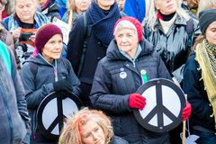 Protesters gather outside the main gate to the AWE, Aldermaston. Aldermaston, United Kingdom, 1st April 2018:- CND protesters gather outside the main gate to the stock photos