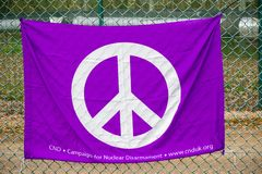 Protesters gather outside the main gate to the AWE, Aldermaston. Aldermaston, United Kingdom, 1st April 2018:- CND protesters gather outside the main gate to the royalty free stock images