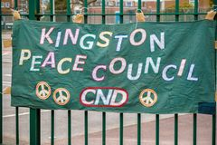 Protesters gather outside the main gate to the AWE, Aldermaston. Aldermaston, United Kingdom, 1st April 2018:- CND protesters gather outside the main gate to the stock images