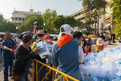 The protesters are helping to move water. BANGKOK,THAILAND-DECEMBER 2 : The protesters are helping to move water to support  head of the line who fighting on Stock Photography
