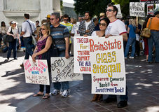 Protesters Hold Signs at Occupy L.A. Stock Images