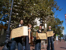 Protesters hold Signs saying things the corruption on Wall Stree Royalty Free Stock Photo