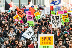 Protesters Holding all kind of Signs, Flags and Placards in the Streets. Stock Images