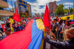 Protesters holding giant flag marching with Stock Images