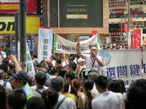 Protesters at Hong Kong June 1 Protest. Protesters form a crowd on the street of Hong Kong's annual June 1 protest in 2013. A speaker from a pan-democratic royalty free stock photo