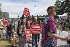Kinder Morgan protesters hold anti trudeau signs on June 2, 2018. Protesters at the Kinder Morgan tank farm hold anti-Trudeau signs now that the Canadian royalty free stock photography