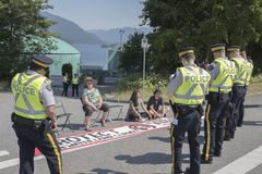 Protesters at the Kinder Morgan Westridge marine terminal in Burnaby, BC. Police confront pipeline expansion protesters at the Kinder Morgan Westridge Marine stock image