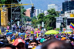 Protesters listen carefully to the words of President Juan Guaidó royalty free stock photos