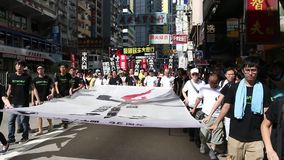 Protesters March ahead of Tiananmen Anniversary in Hong Kong. On 1 Jun 2014 stock video footage