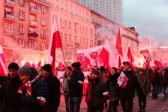 Independence Day March in Warsaw Poland Marred by Violence and Controversy. Protesters march at the annual Polish Independence day march in Warsaw surrounded by Royalty Free Stock Photo