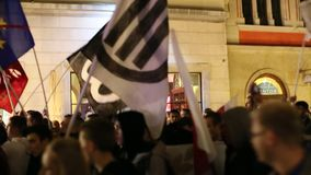 Protesters march through center of city stock video footage