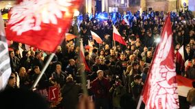 Protesters march through center of Krakow. stock video footage