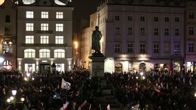 Protesters march through center of Krakow. stock video