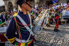 Protesters & marching band, Independence Day, Guatemala. Antigua, Guatemala - September 15, 2017: Protesting against government corruption in front of city hall stock images