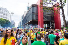 Protesters marching on Paulista Avenue holding signs with messages against the corruption of Brazilian government in Sao Paulo Royalty Free Stock Images