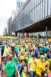 Protesters marching on Paulista Avenue holding signs with messages against the corruption of Brazilian government in Sao Paulo Stock Photography