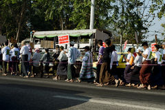 Protesters marching peacefully in Yangon Stock Photo