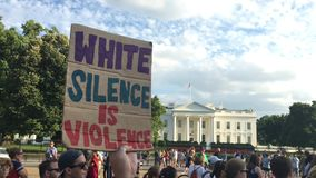 Protesters Outside The White House Hold Signs. 8990 WASHINGTON, D.C. - Circa August, 2017 - A large group of protesters hold anti-hate signs outside The White stock video