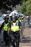 Protesters and police at a demonstration Royalty Free Stock Image