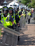 Protesters and police at a demonstration Royalty Free Stock Photo