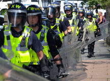 Protesters and police at a demonstration Stock Photo