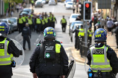 Protesters and police at a demonstration Stock Photos
