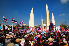 Protesters raise Thai flags at Democracy Monument Stock Photo
