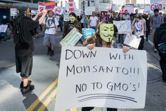 Protesters rallied in the streets against the Monsanto corporation stock image