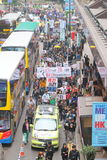 Protesters Rally to Demand Answers for Disappearance HK Publishers. Protesters marched from the Central Government Complex to the China Liaison Office request royalty free stock image