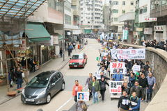 Protesters Rally to Demand Answers for Disappearance HK Publishers. Protesters marched from the Central Government Complex to the China Liaison Office request royalty free stock images