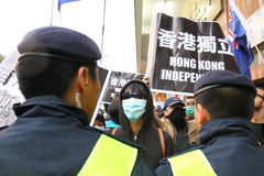 Protesters Rally to Demand Answers for Disappearance HK Publishers. Protesters marched from the Central Government Complex to the China Liaison Office request royalty free stock photo