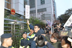 Protesters Rally to Demand Answers for Disappearance HK Publishers. Protesters marched from the Central Government Complex to the China Liaison Office request royalty free stock photos