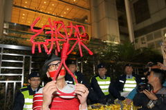 Protesters Rally to Demand Answers for Disappearance HK Publishers. Protesters marched from the Central Government Complex to the China Liaison Office request stock images