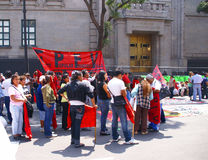 Protesters with red flags Stock Images