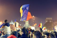 Protesters at #rezist, Bucharest, Romania. Protesters with flags and signs at #rezist demonstration in Bucharest, Romania at night Stock Photography