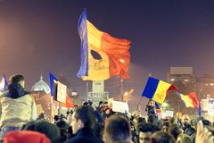 Protesters at #rezist demonstration, Bucharest, Romania. Protesters at #rezist demonstration in Bucharest, Romania at night Stock Photos