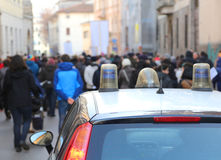 Protesters rioting during a protest in the street and the police Stock Photography