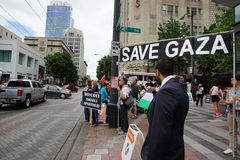 Protesters with save Gaza sign Royalty Free Stock Photos