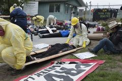 Kinder Morgan protesters stage a die in at the Kinder Morgan tank farm on Burnaby Mountain, BC. Kinder Morgan protesters stage a die in on May 16 to illustrate stock photos