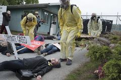 Kinder Morgan protesters stage a die-in at the Kinder Morgan tank farm on Burnaby Mountain. Kinder Morgan protesters play dead in a die in on May 16 to stock photo